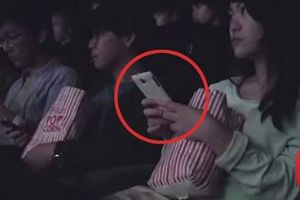 Watch these people whip out their mobile phones in movie theater. They Never Saw it Coming!