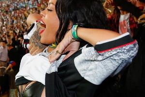 Rihanna flashes leather bra at the 2014 FIFA World Cup Final and parties with the champions (12 pics)