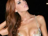 English Glamour Model Maria Fowler wears a super low cut dress at her birthday party
