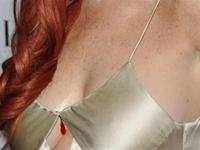 Lindsay Lohan in gold gown at Lifetime`s Liz & Dick premiere in Beverly Hills