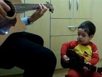 Father And Two-Year-Old Son Play `Dont Let Me Down` by The Beatles