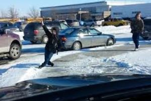 Dad picking up his kids from school has a good laugh while watching other students fall on ice