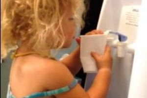 Little Girl Doesn't Understand How Water Cooler Works