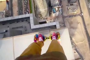 This is hard to watch! Guy rides his hoverboard around on the edge of a damn skyscraper, just inches away from total disaster!
