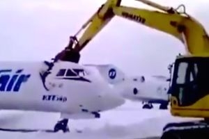 Russian airport worker gets fired, so on his last day he gets in a digger and peeled a $5 million jet open like a can of sardines!