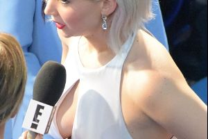 Jennifer Lawrence Goes Braless and Flashes Cleavage In Dior Custom Cut Out Dress at London fan screening of X-Men