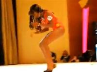 Miss Cote D`ivoire 2012 struggling with her monster heels on stage