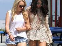 Selena Gomez looking hot in shorts and boots out walking with the girls in California