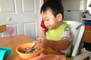 Baby eating breakfast while on a toy phone becomes the internet's favorite CEO (13 pics)