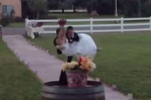 Groom Drops Bride While Carrying Her Into Their Wedding Reception