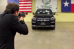 Man shot an AK 47 at a Mercedes Benz while the owner of Texas Armoring Corporation sits in this SUV