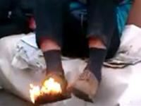 Sir, your shoe is on fire! You are not going to put it out?