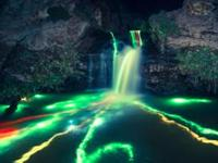 Glow Sticks Thrown into Waterfalls Create Amazing Underwater Rainbows