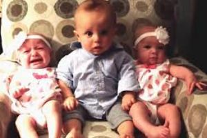 When a baby meets twins -- The look on his face ....PRICELESS!!!