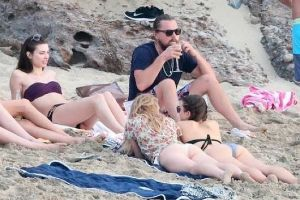 Bearded Leonardo DiCaprio`s New Year Beach Party with A Bevy of Sexy Girls (30 photos)