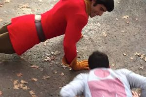 Meanwhile at the happiest place on earth: some poor pool challenged beauty and the beast`s Gaston to a push up contest at Disneyland