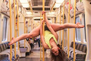 Woman Pole Dancing On A Public Train Gives Commuters Something To REALLY Look At. Wow.