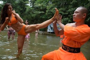 Tough job for monks! Chinese Rescuers Are Put on Intense Training Course with Monks While Wearing Bikinis