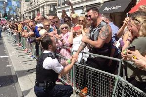 Meanwhile at London Gay Pride…Police officer drops down onto one knee and proposes to his boyfriend in front of thousands of people!