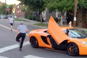 Skate or Die! – Dude driving a $350,000AUD McLaren runs a stops sign, tells skateboarder on the crossing to `f**ken move bitch`, gets paid back instantly.