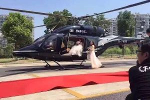 Someone needs to give this couple their own reality show called `Rich Kids of Shanghai`. Man picks bride up in helicopter, causes massive traffic jam.