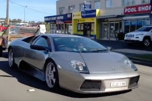 Rich Aussie bloke spotted using a Lamborghini to tow a rusty old trailer around Sydney full of goats and hay!
