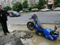 Motorcycle stuck in a road hole