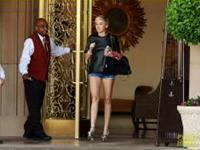 Miley Cyrus rocking her legs in shorts and metallic heels in Beverly Hills