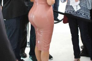 Kim Kardashian showing her massive bum in a pink latex dress at Formula One event