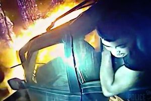 Cop saves man trapped inside a burning 4WD after a high speed crash, the driver was burned to death before officers arrived