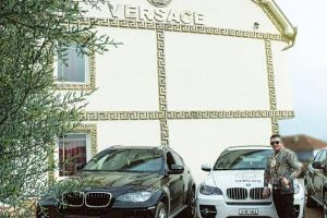 Everything this Versace-Obsessed man owns virtually has The Versace name on it, even his house.