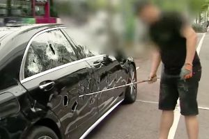Korean business man destroys a $350,000 Mercedes S63 with his golf club to protest sh*t customer service.