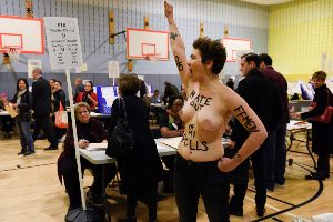 NUDE VOTE! Two Topless Trump Protestors Storm Into A Polling Place In New York