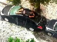 Man Desperately Protects Car From Hail