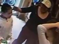 Mom and little daughter team up to steal at a cloth shop in Vietnam