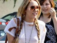 Miley Cyrus in jean shorts and white tshirt in Toluka lake