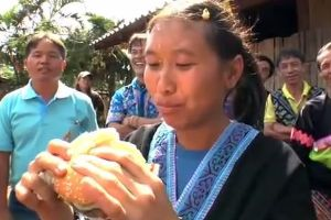 Hmong and Romanian people eating burgers for the first time in their lives