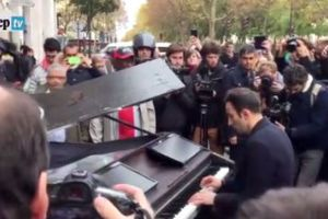 Man Plays A Classic Peace Anthem In The Streets Of Paris Near The Recent Tragedy