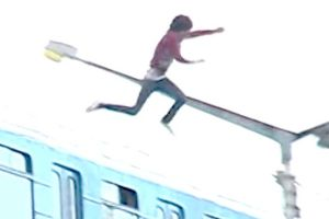 Meanwhile in Ukraine…Crazy bastard leaps off a moving train while travelling over an 80ft high bridge, lands in the freezing Dnipro River!