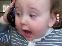 Baby using cellphone to make an important phone call. About what?