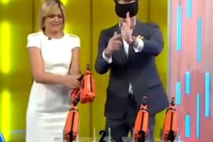 Blonde TV host almost shoots herself in the f**king face with a nail gun